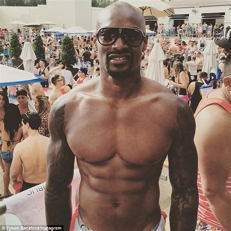 Chris Brown and Tyson Beckford exchange 'threats' over