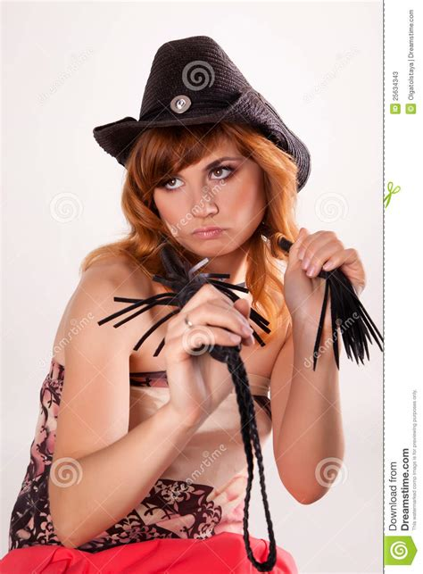 Beautiful Girl In The Hat And Whip Stock Image - Image of