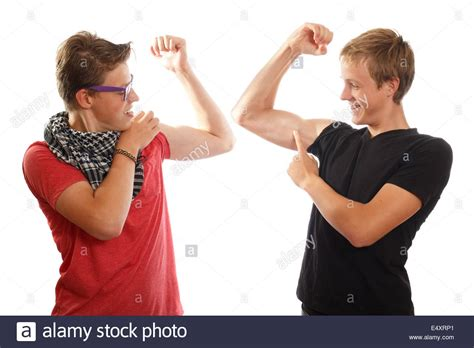 Boys showing off muscles Stock Photo - Alamy
